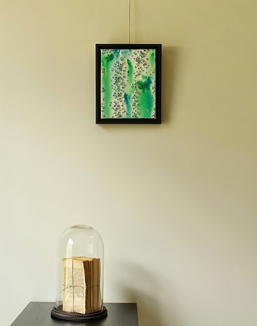 mixed media abstract art with surrounding photo
