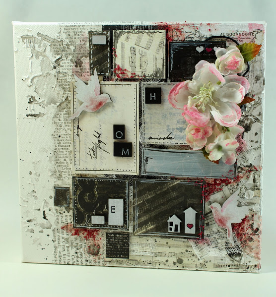 mixed media canvas collage with um wow studio chipboard