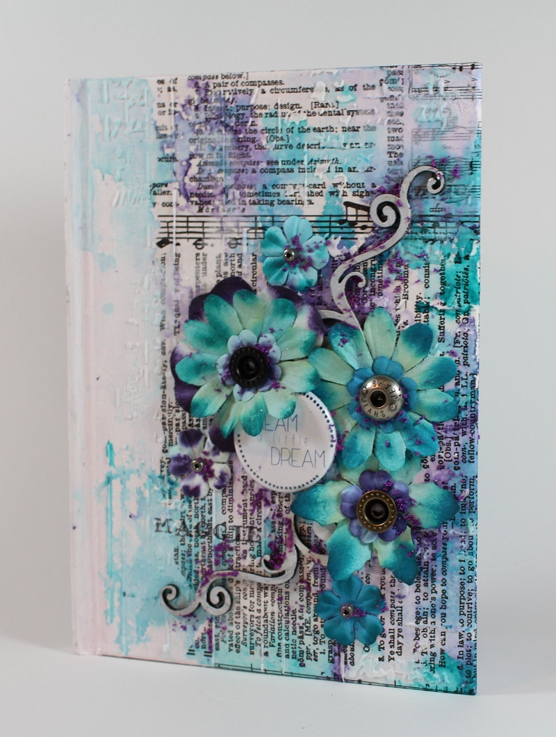 altered covers with texture paste and embellishments